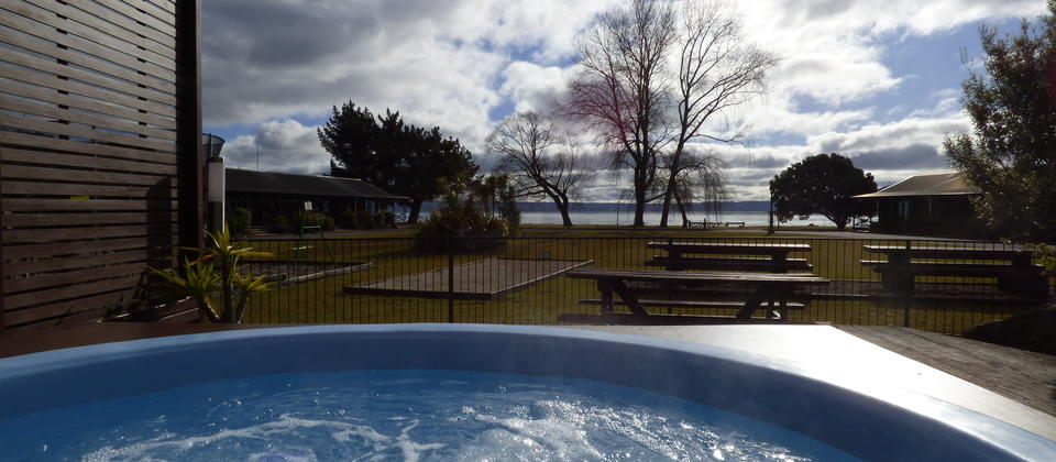 Relax in our outdoor Spa pool with views of the lake.