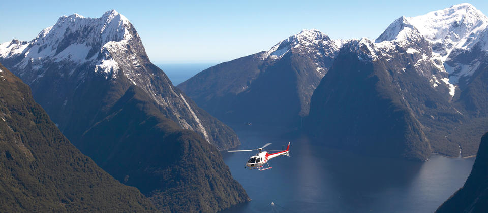 Explore Milford Sound and the glaciers of Fiordland National Park from the air.
