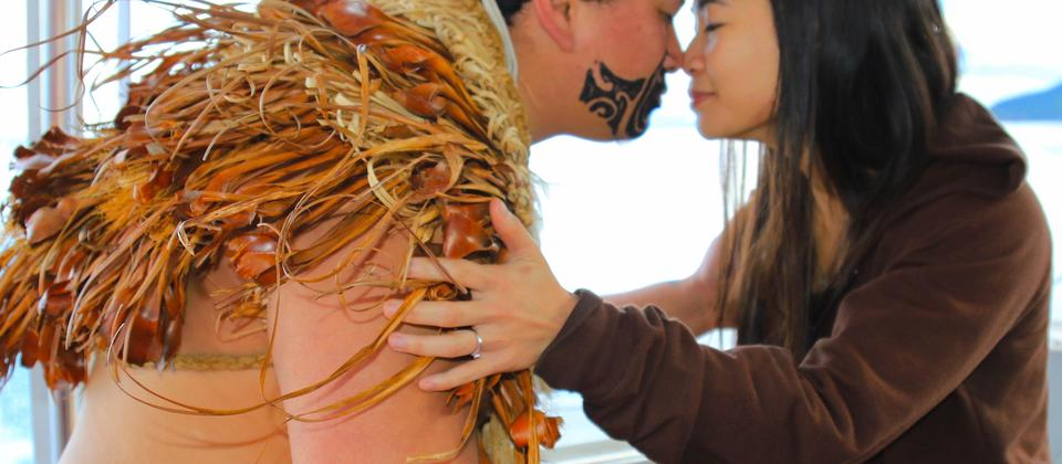 Experience the hongi, a traditional Maori greeting on the Taurikura Maori Cultural Scenic Cruise Experience