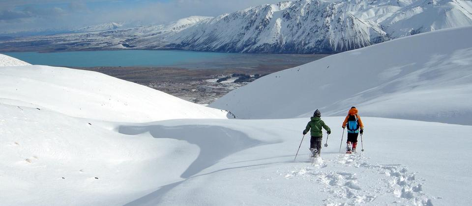 Snowshoeing high above Lake Tekapo in the foothills of the Southern Alps.