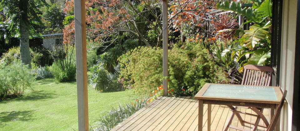 Private deck over looking gardens at Wharepuke