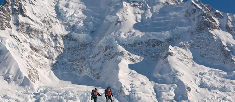Snowshoers in front of the Caroline Face of Aoraki Mount Cook