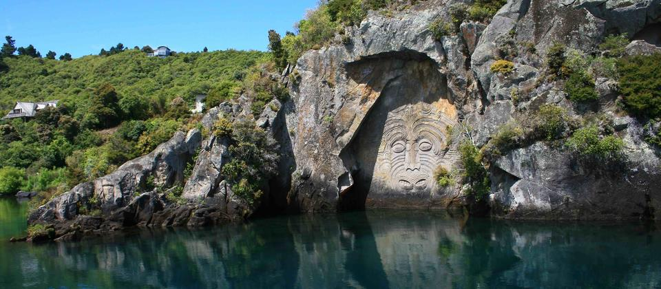 View the Maori Rock Carvings up close on the Taurikura Maori Cultural Scenic Cruise Experience
