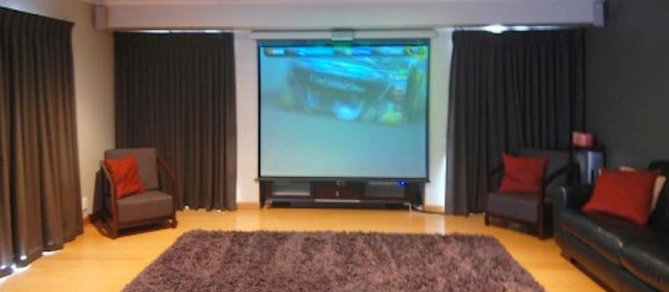 Home theatre with massive screen and projector