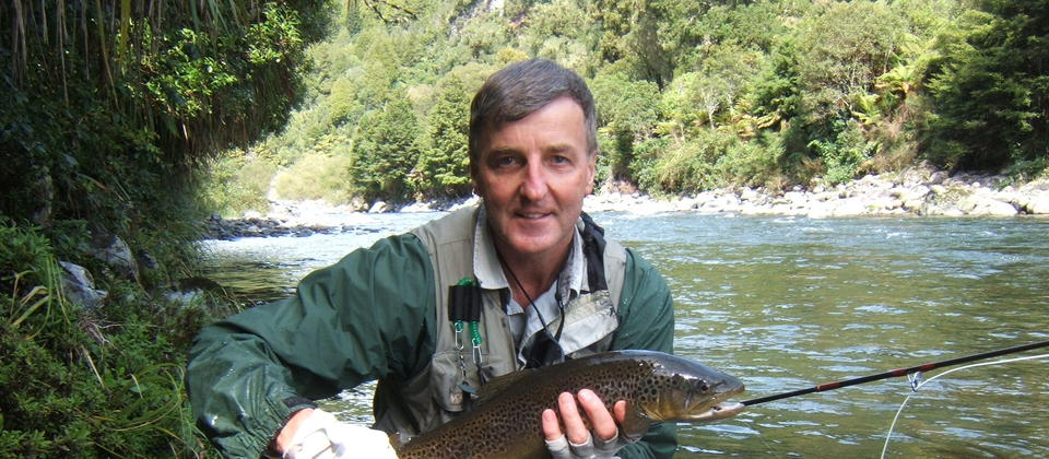 Happy client with a beautiful Brown Trout