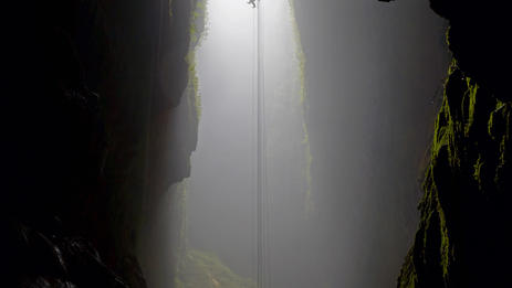 Surreal Freehanging descent alongside your guide during abseil into Lost World Cave