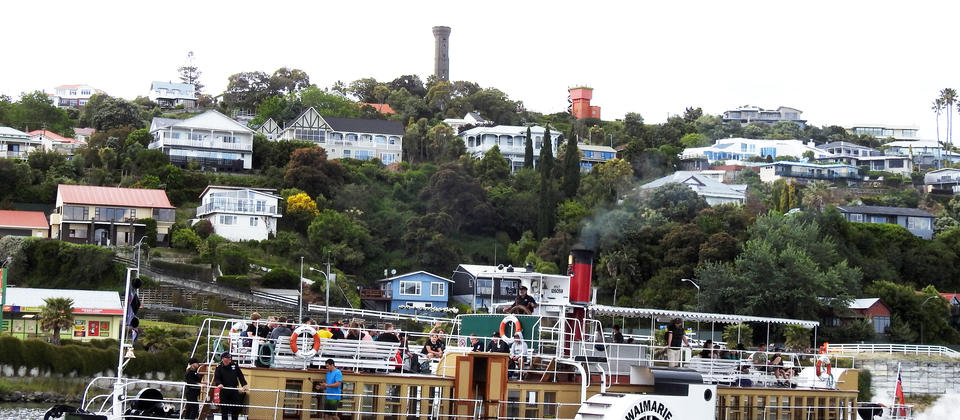The Paddle Steamer Waimarie leaving her berth with the Durie Hill Memorial Tower and Elevator Tower in the background