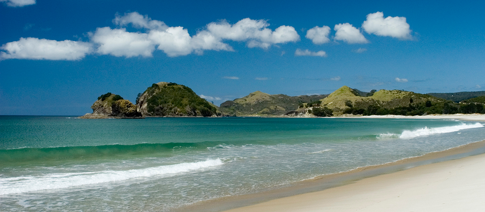 Great Barrier Island is a world away from Auckland City. It's white sand beaches promise to beckon you for a swim.