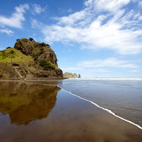 The majestic 'Lion Rock' stands guard over Piha beach