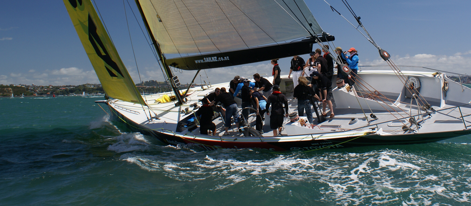Experience Auckland Harbour as a crew member on an real America's Cup yacht.
