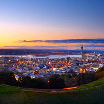 The evening skyline of Auckland's city lights from Mount Eden.