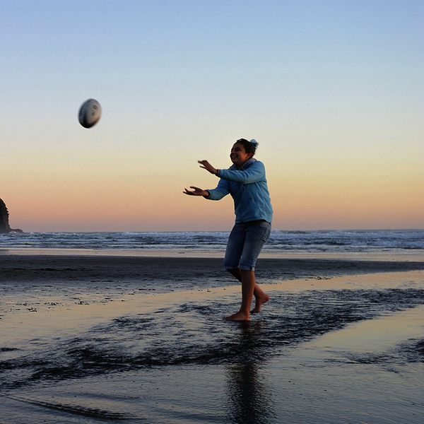 Playing around on Piha beach, Auckland