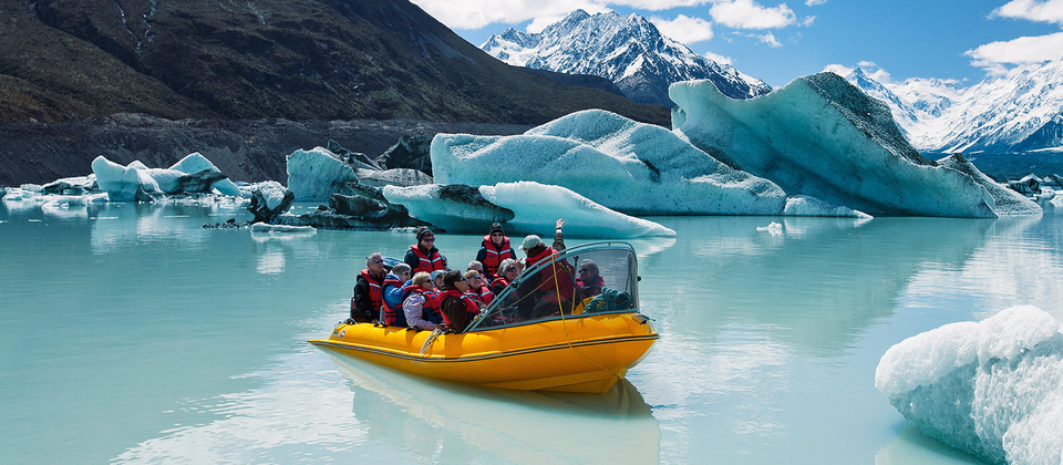 Glacier Explorers take visitors to see the Tasman Glacier and touch floating ice