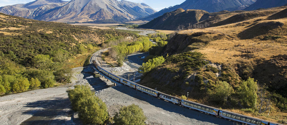 One of the world's great train journeys, travelling coast to coast through forests and farmland and over the spectacular Southern Alps.
