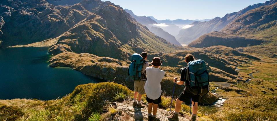 Hike through golden valleys on the Routeburn Track.