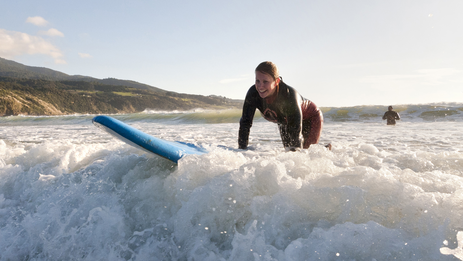 Learning to surf at Ngarunui Beach, Raglan