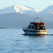 Take in dramatic volcanoes, rolling farmland and carved rock on a boat cruise around Lake Taupō