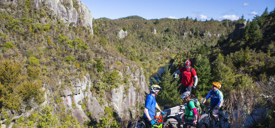 Ride through rich native bush and past towering volcanic cliffs on this epic cycle trail.