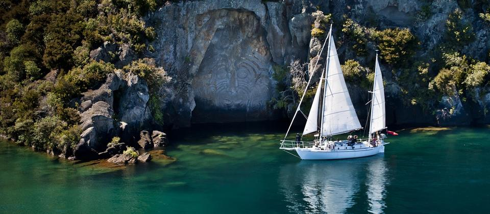 Viewing the Mine Bay Maori Rock Carvings by sailboat