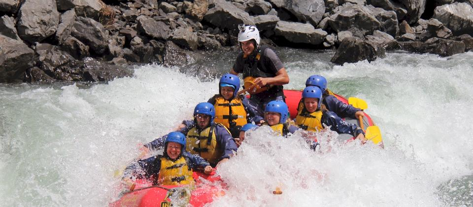 A raft in Foamy Rapid on the Grade 5 section of the Rangitikei River, North Island
