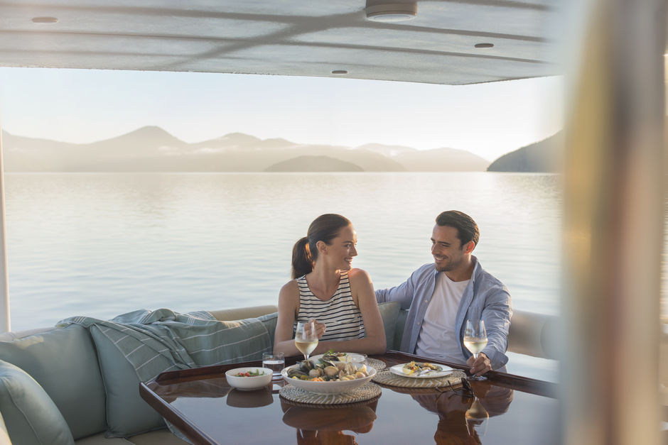 Enjoy Marlborough's crisp wines as you soak in the beautiful vistas of Queen Charlotte Sound on a cruise.