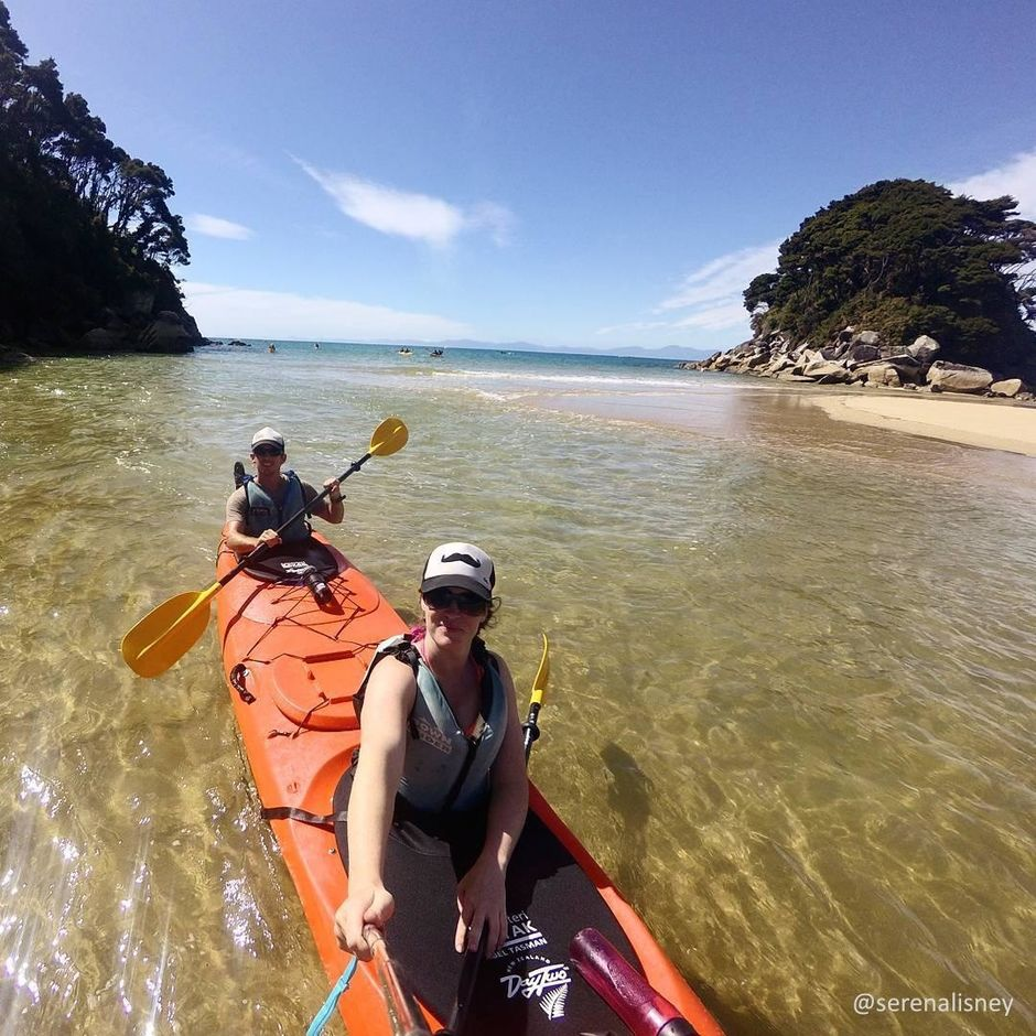 Kayakers enjoying the crystal clear waters and beautiful beaches in sunny Nelson Tasman.