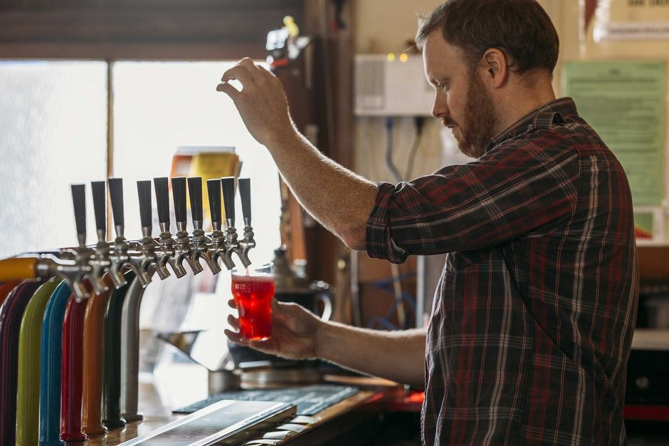 The Free House serves beer from 11 brightly-coloured taps