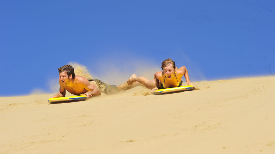 Sandboarding the dunes in Hokianga