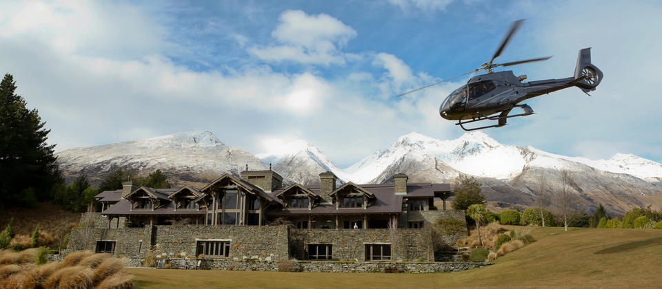 The Airbus H130 arriving at luxury lodge, Blanket Bay