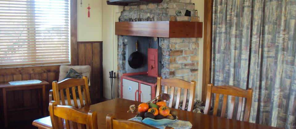 Wharf Hub kitchen dinning area with wood stove in Winter