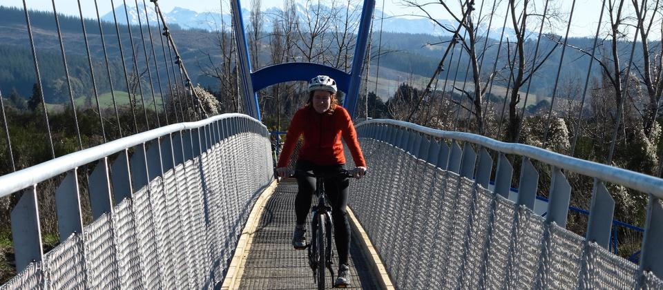 Mandy cycling over the new bridge near Brightwater