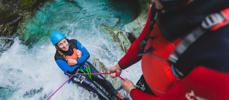 Full Day Canyoning Routeburn - lowering into water.jpg
