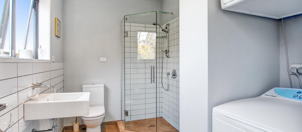 Second Bathroom with a shower and laundry