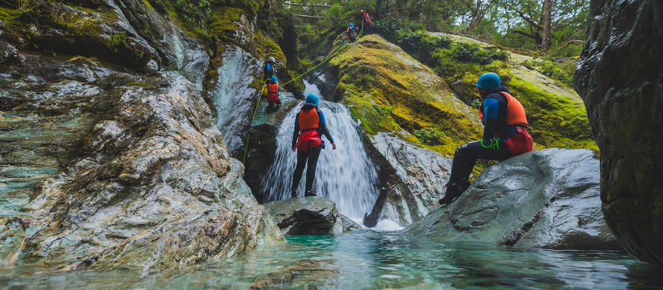 Canyoning down waterfall - Routeburn.jpg