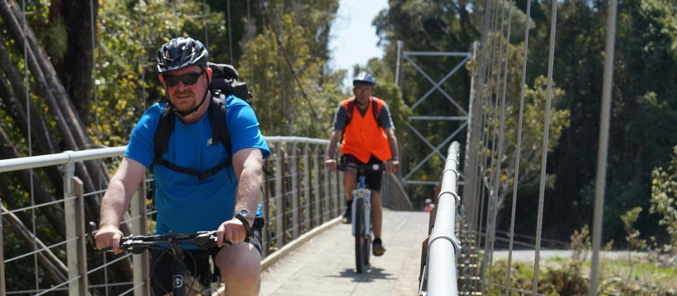 Crossing suspension bridge near Kumara