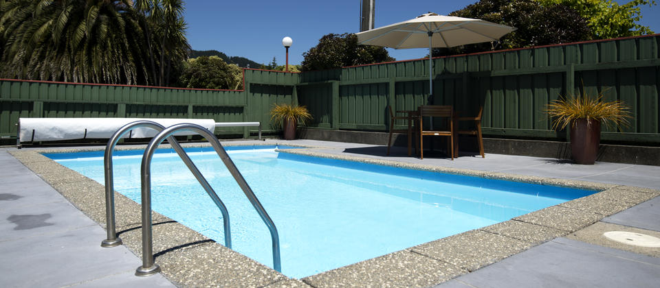 Solar-heated summer pool