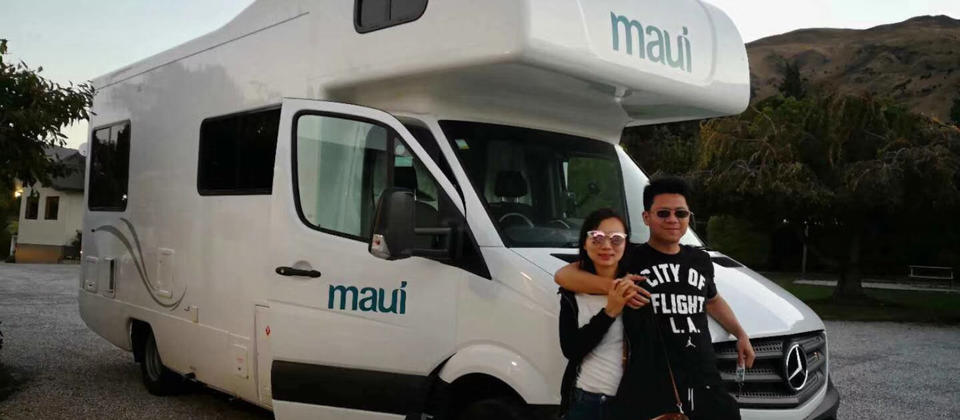 An asian couple enjoying their New Zealand motorhome holiday