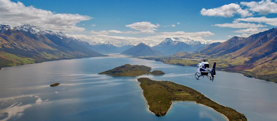 Heli Glenorchy EC-120 helicopter flying towards Glenorchy over Pigeon & Pig Islands
