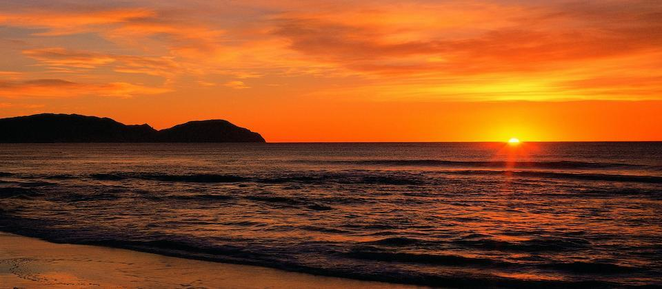 Sunrise at Wainui Beach