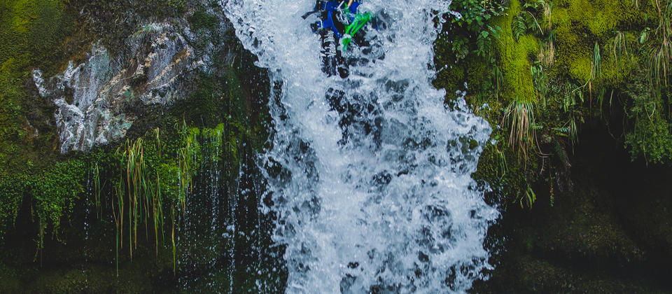 Full Day Canyoning Routeburn - sliding down waterfall.jpg