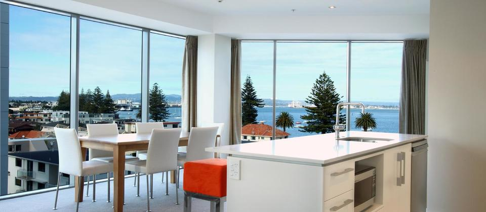 Kitchen dining area of a 2 bedroom apartment, with sea views. Pacific Resort Apartments, Mt Maunganui.
