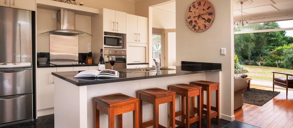 A fully renovated modern kitchen offers all the utensils and equipment for preparing great meals.