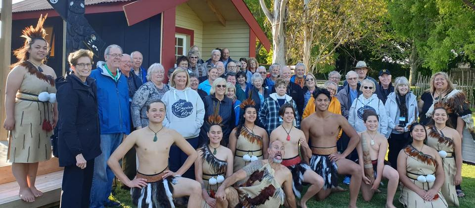 Happy visitors to Te Ahi Kaa Whare.jpg