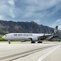 Air New Zealand plane at the beautiful Queenstown Airport, nestled in the mountains near Lake Wakatipu.