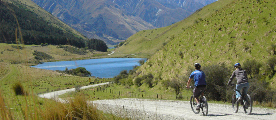 Backdropped by golden, tussocky peaks, riding around Moke Lake is a truly serene mountain biking experience.