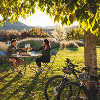 Whether it is by bike, bus, car or helicopter - there is plenty to discover among Queenstown's many world-class wineries and vibrant town nightlife.