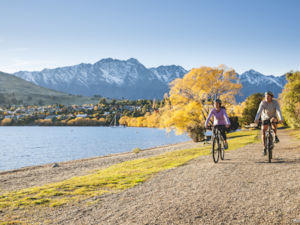 Cycling by Lake Wakatipu in autumn