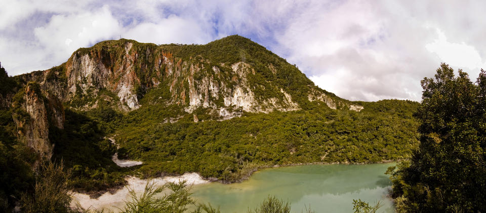 The Crater Lakes Walk offers great views of two volcanic craters set against a backdrop of bare brown, orange and red steaming cliffs.