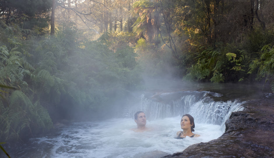 Soak in the natural hot springs of Kerosene Creek, Rotorua