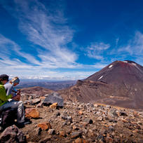 The plateau rest stop at the highest point of the Tongariro Alpine Crossing is a chance to grab a snack and take in the stunning scenery.